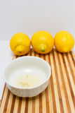 Freshly squeezed lemon juice inside a white bowl Royalty Free Stock Image