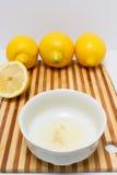 Freshly squeezed lemon juice inside a white bowl Stock Photography