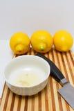 Freshly squeezed lemon juice inside a white bowl Royalty Free Stock Photo