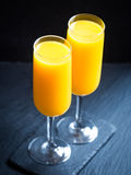 Freshly squeezed orange juice in champagne glasses Royalty Free Stock Image