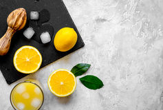 Freshly squeezed orange juice on concrete background top view.  Royalty Free Stock Photo