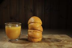 Freshly squeezed orange juice with spent oranges Stock Photo