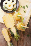 Freshly squeezed pineapple juice in a glass jar closeup. Vertica Royalty Free Stock Images