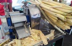 Freshly squeezed sugar cane juice machine Royalty Free Stock Images