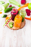 Freshly squeezed vegetable juice in bottles, useful vitamin cock Royalty Free Stock Photos