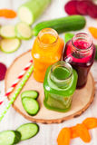Freshly squeezed vegetable juice in bottles, useful vitamin cock Stock Photography