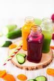 Freshly squeezed vegetable juice in bottles, useful vitamin cock Royalty Free Stock Image