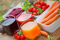 Freshly squeezed vegetable juices. Carrot juice, tomato juice and beet juice Royalty Free Stock Photos