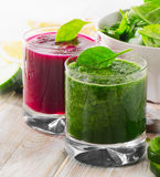 Freshly Squeezed Vegetable Juices on a wooden table Stock Photo
