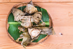 Freshly steamed Chinese rice dumpling on traditional rattan tray Stock Photography