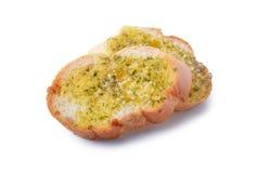 Freshly toasted garlic bread. Isolated on white background Stock Photos