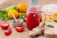 Freshly tomato juice with tomato slice, ginger ,oranges , honey Royalty Free Stock Photography