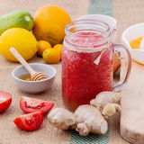 Freshly tomato juice with tomato slice, ginger ,oranges , honey Royalty Free Stock Images