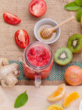 Freshly tomato juice with tomato slice, ginger ,oranges , honey Royalty Free Stock Image
