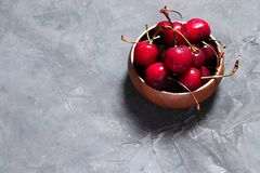 Freshly washed cherries in wooden bowl stock photos