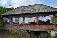 Freshly washed clothes on house porch stock photography