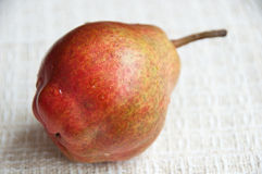 Close up of an organic Bartlett pear on a cloth napkin Stock Photography