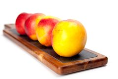 Freshly washed peach  on wooden cutting board isolated on white Royalty Free Stock Photography