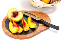 Freshly washed peach  on wooden cutting board with knife Royalty Free Stock Photo