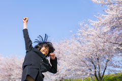 Freshman of Japan. New freshman to jump in front of a cherry tree in full bloom Stock Photography