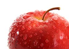 Freshness. Drops of water on the ripe red aplle royalty free stock photo