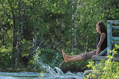 Freshness!. Girl playing with river splashes Stock Photo