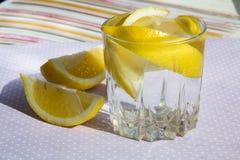 Freshness concept, homemade lemonade Summer detox drink with lemon in glass jars. Fresh water, refreshment drink Stock Photo