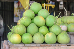 Freshness green grapefruit are selling at market Royalty Free Stock Images