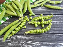 Freshness green peas harvest nutrition healthy organic on a black wooden background. Freshness green peas a black wooden background vitamin harvest  healthy Royalty Free Stock Images