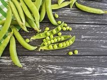 Freshness green peas harvest nutrition seed healthy organic on a black wooden background. Freshness green peas a black wooden background vitamin  healthy rural Royalty Free Stock Image