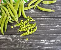 Freshness green peas harvest nutrition season healthy organic on a black wooden background. Freshness green peas a black wooden background vitamin harvest Royalty Free Stock Image