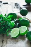 Freshness, Ingredients for making  summer drink mojito. Freshness, ingredients for making refreshing summer cold drink mojito cocktail on rustic wooden table stock photo