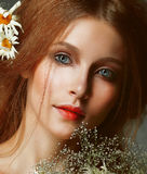 Freshness. Portrait of Romantic Redhead Woman with Chamomile. Young Pretty Red head Woman with Flowers stock photo