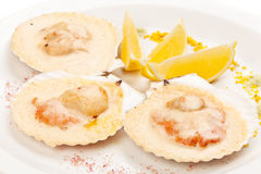 Freshness scallop with lemon Stock Photos