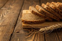 Freshness sliced grain bread on a wooden Board. Freshness sliced grain keto bread on a wooden Board stock image