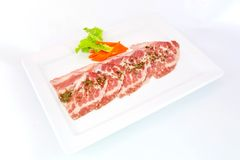 Freshness slided pork on white dish for grill Royalty Free Stock Images