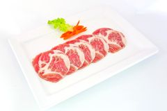 Freshness slided pork on white dish for grill Stock Photo