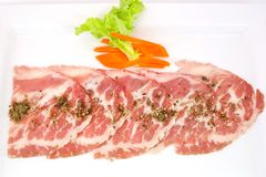 Freshness slided pork on white dish for grill Royalty Free Stock Photo