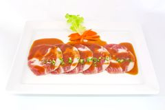 Freshness slided pork on white dish for grill Stock Images