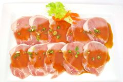 Freshness slided pork on white dish for grill Stock Photography