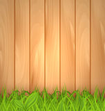 Freshness spring green grass and wooden wall Royalty Free Stock Photo