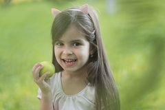Freshness youth growth nutrition. Freshness, youth, growth, nutrition. Little girl smile with apple on natural background, vitamin. Health, healthcare, healthy stock photos