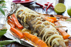 Freshwater fish baked in foil Stock Photos