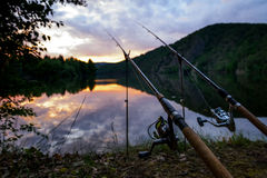Freshwater fishing with rods on Vltava at sunset Stock Images