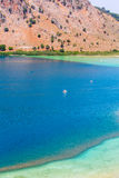 Freshwater lake in village Kavros in Crete  island, Greece. Magical turquoise waters, lagoons. Royalty Free Stock Image