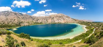 Freshwater lake in village Kavros in Crete  island, Greece. Magical turquoise waters, lagoons. Stock Photos