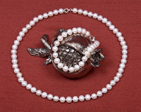 Freshwater pearl necklace and pomegranate shabbat decoration Stock Photography
