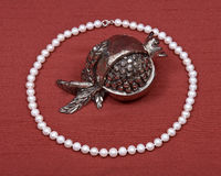Freshwater pearl necklace and pomegranate shabbat decoration Royalty Free Stock Images