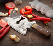 Fresj tomatoes, garlik and old knife on a wooden Stock Photo