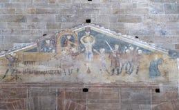 Fresk uwypukla męczeństwo święty Lawrance, Vincent i Stephen w bazylice święty Frediano, Lucca, Włochy Obrazy Stock